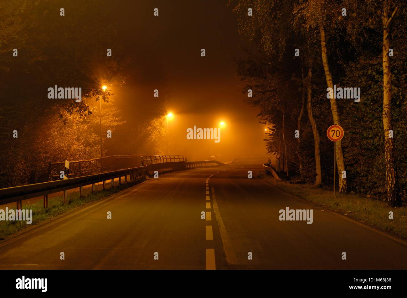 Landstrasse im Nebel Stock Photo