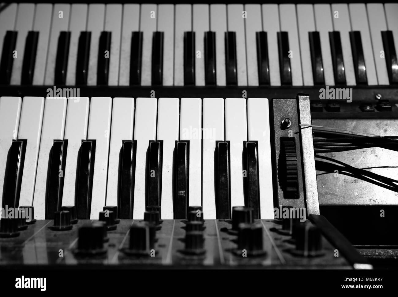 vintage piano and sound synthesizer instrument used in live concert - Stock Image