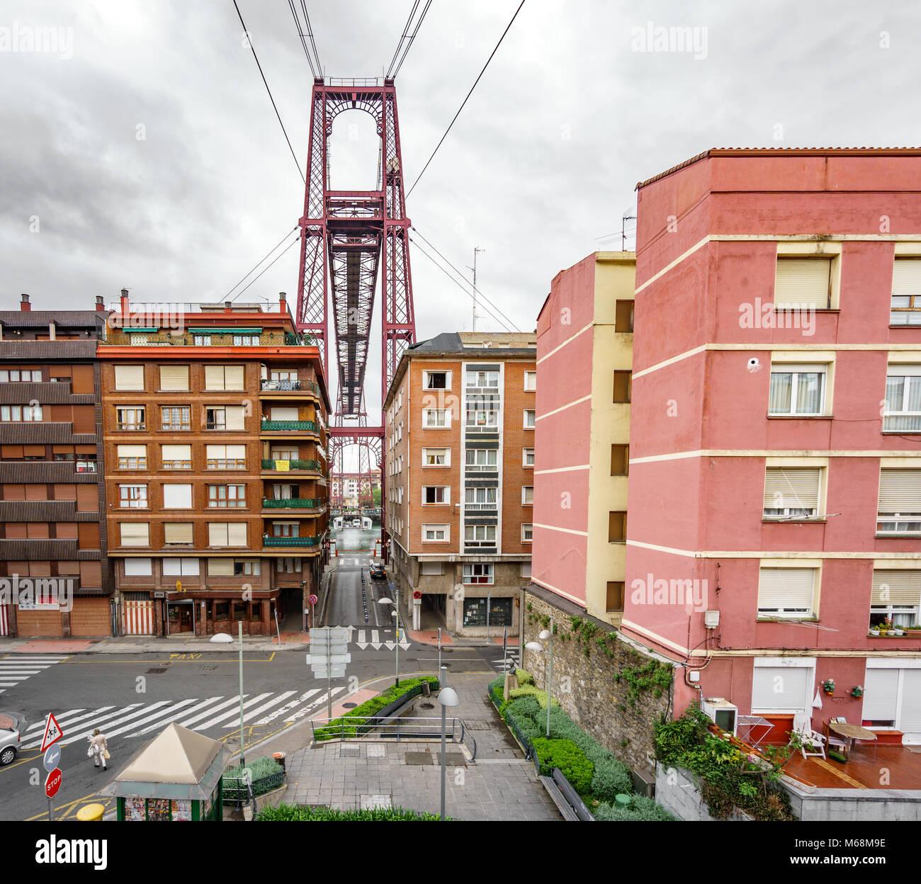 Bizkaia suspension bridge behind buildings - Stock Image