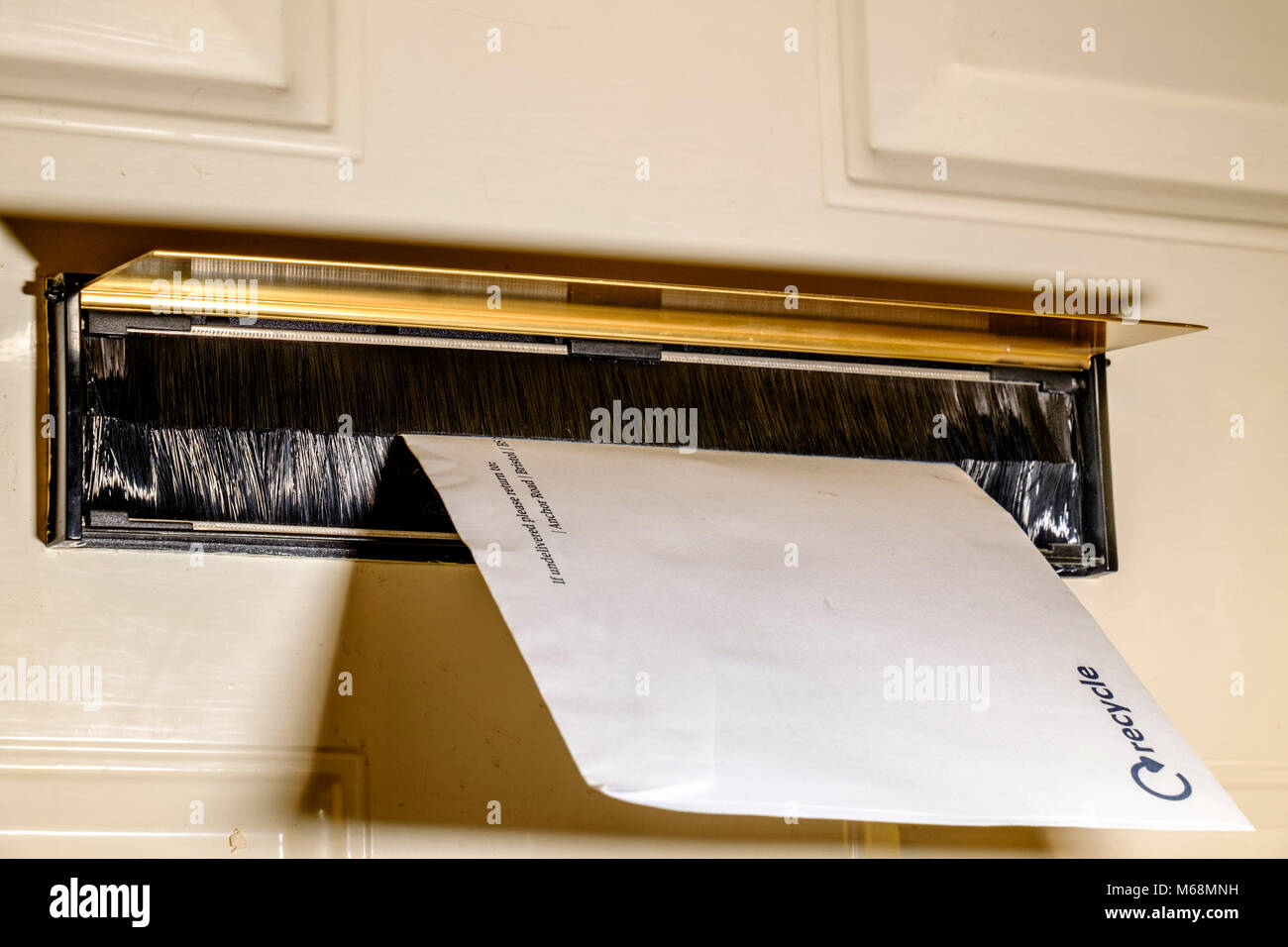 A draft excluder fitted to a front door, - Stock Image