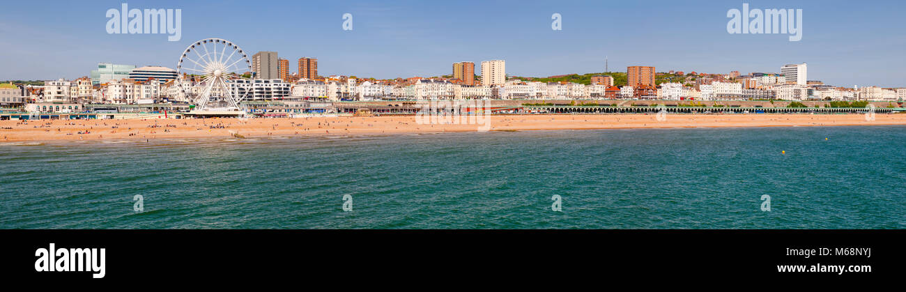 Brighton Beachfront panoramic view with the Ferris Wheel promenade and shingle beach pictured from the Brighton - Stock Image