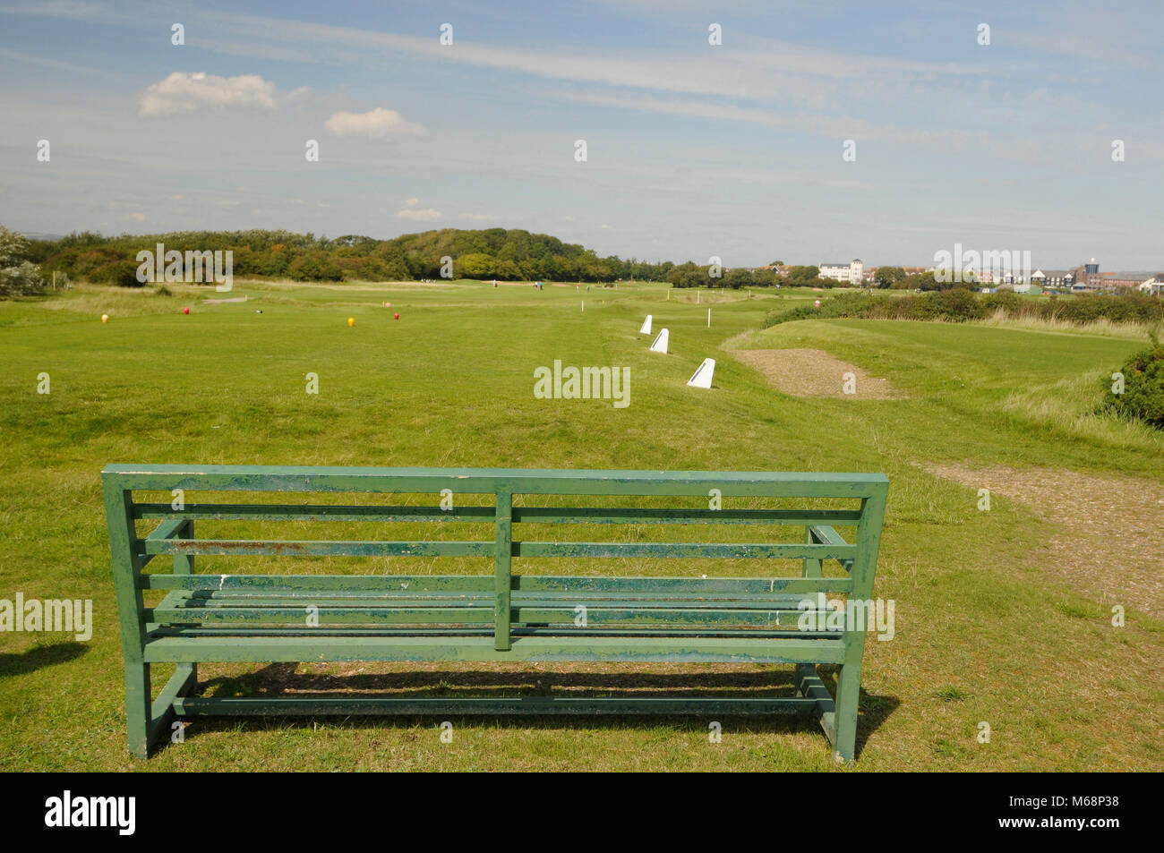 View over bench to 14th Tee and fairway, Littlehampton Golf course, Littlehampton, Sussex, England Stock Photo