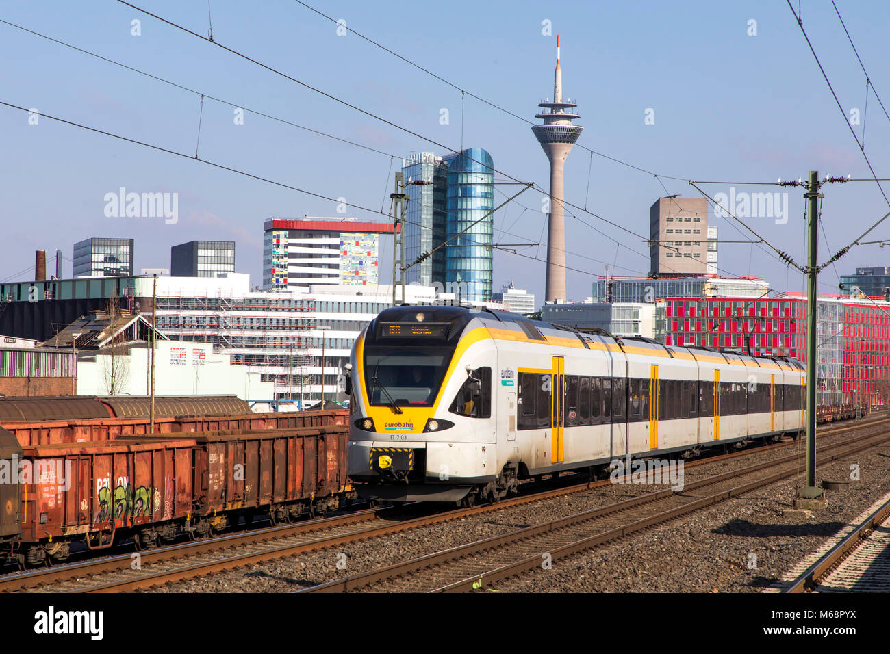 S-Bahn, Local train station, Dusseldorf-Hamm stop, the skyline of Düsseldorf city center, Medienhafen, Media port area,  commuter train, Düsseldorf, G Stock Photo