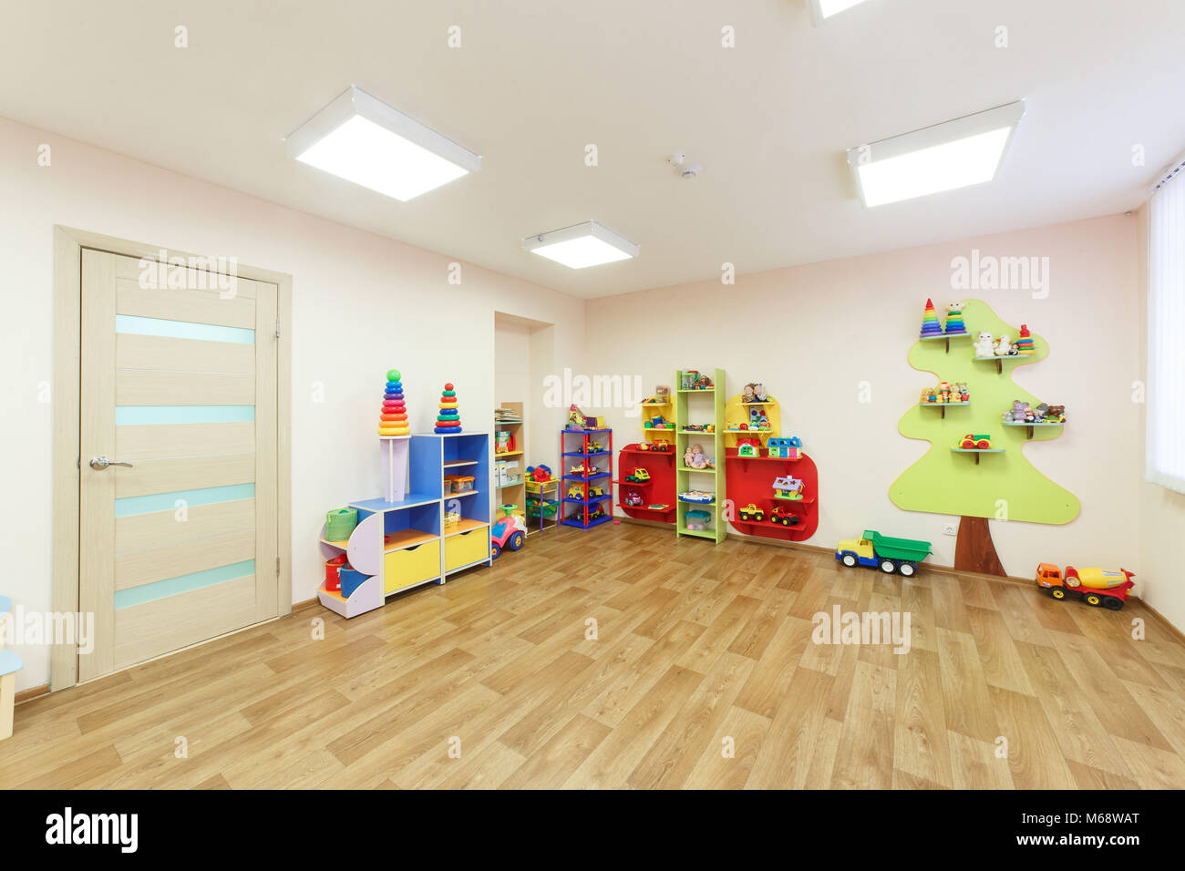 Light pink colored game room in the kindergarten - Stock Image