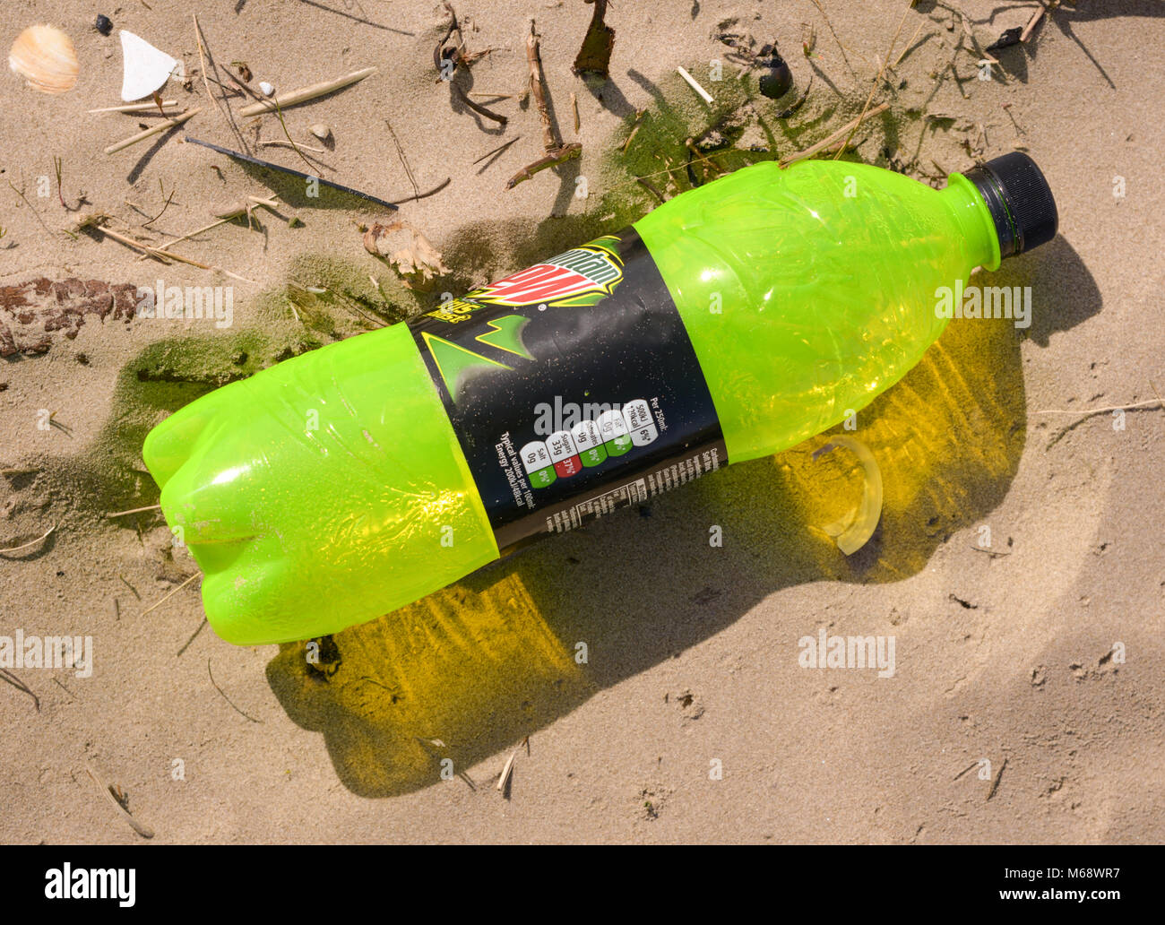 Detritus and rubbish washed up on Cefn Sidan, Pembrey, Carmarthenshire. Wales. UK. - Stock Image