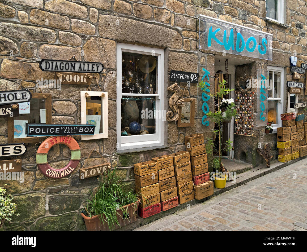Eclectic display of goods outside Kudos old curiosity, antique and collectables shop in Fore Street, St. Ives, Cornwall, - Stock Image