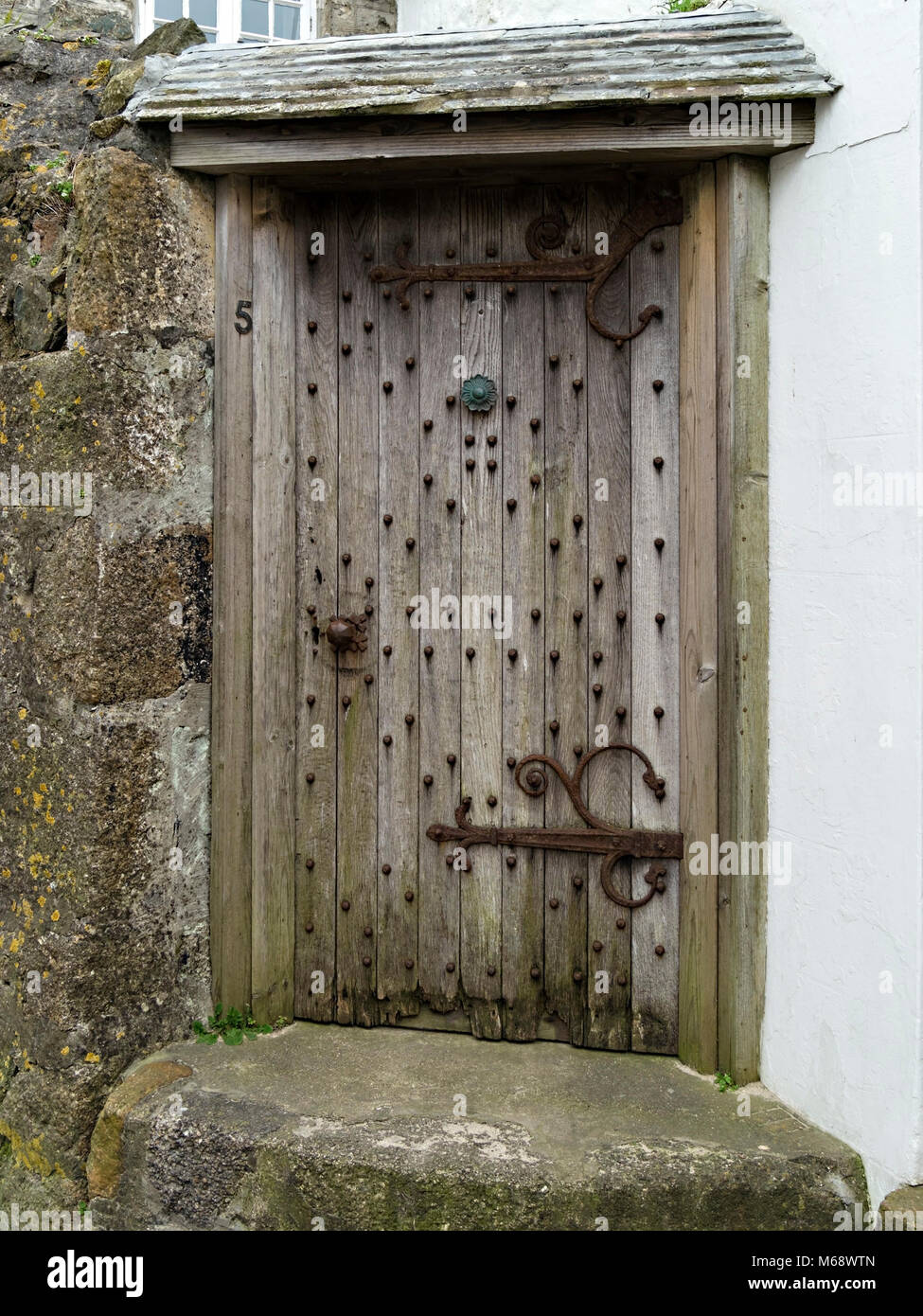 Old Oak Front Door With Iron Fittings In Granite Stone Wall Of What Is  Reputedly The