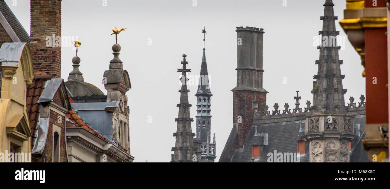 Gothic church spires and steeples adorn the architectural skyline of Bruges's ancient and medieval city on an October Stock Photo