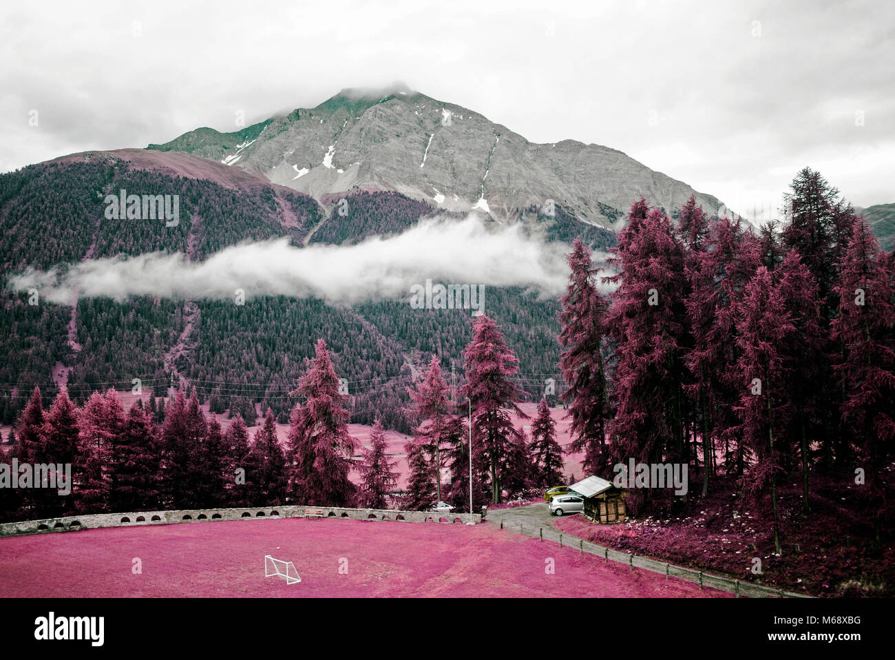 Beautiful landscape and mountains in the alps switzerland in color infrared - Stock Image