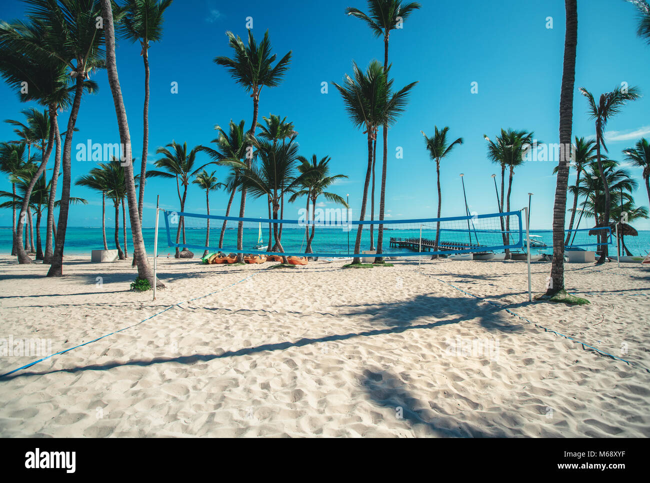 Volleyball net on tropical beach, caribbean sea. - Stock Image