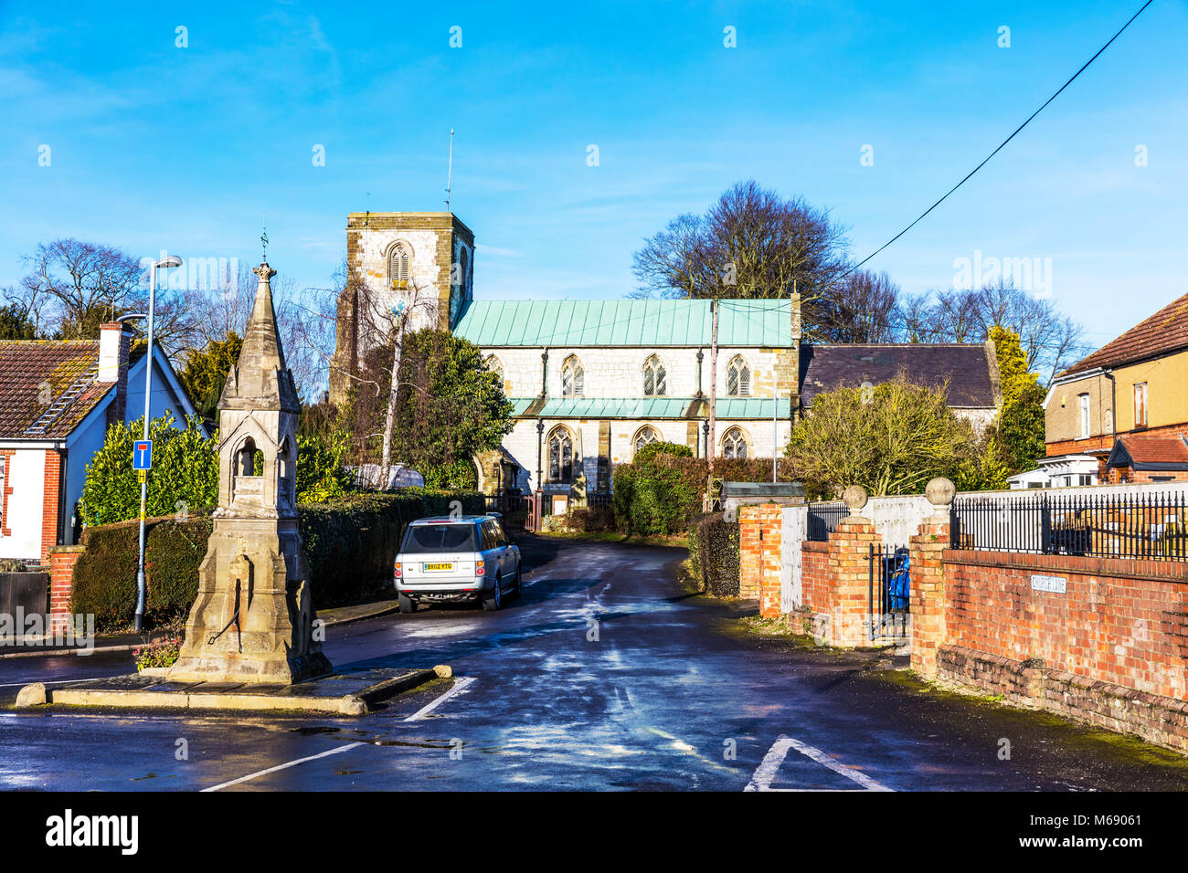 Legbourne village church and water pump, All Saints Church is a Grade 1 listed building. It was built in 1380 and Stock Photo