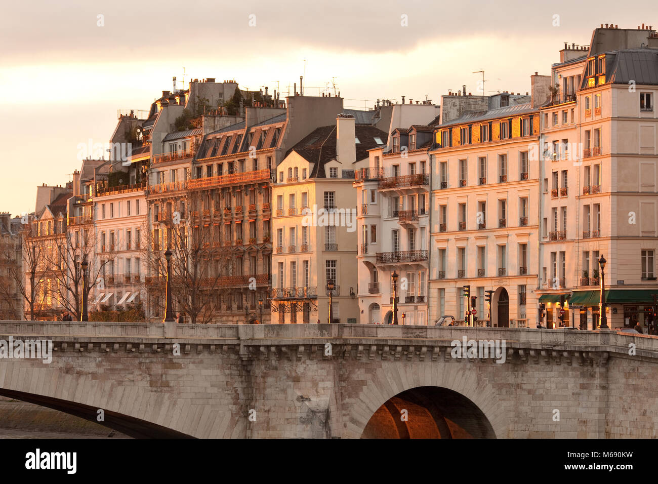 Facades of apartment buildings at Ile Saint Louis and Pont de la Tournelle bridge, Paris, France - Stock Image