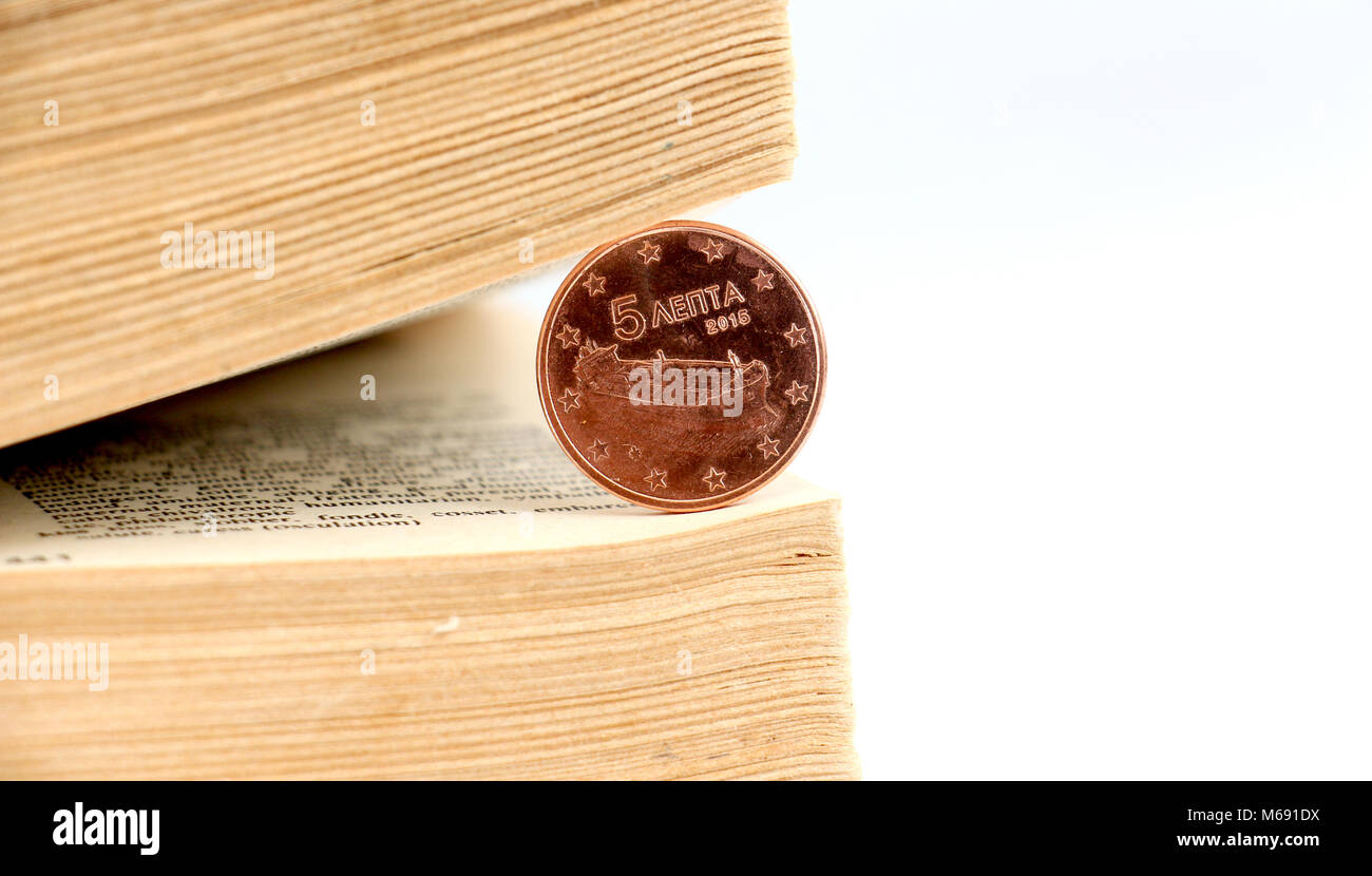 five euro cent coinbetween pages of an old book, image - Stock Image