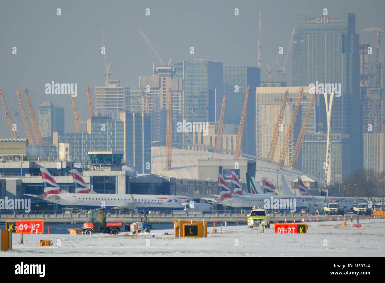 Snow disrupting flights at London City Airport in East London due to snow that was part of #BeastfromtheEast winter - Stock Image