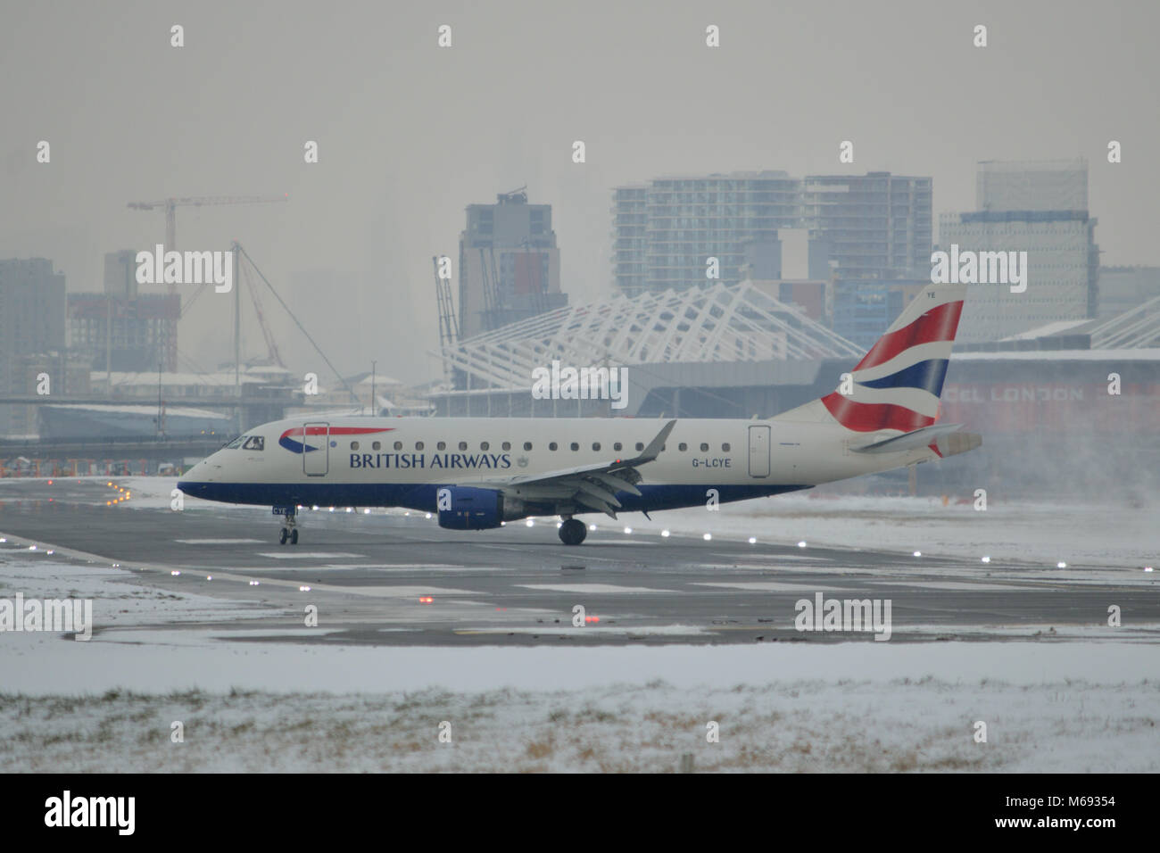 London, UK, 28th February 2018 Snow disrupting flights at London City Airport in East London due to snow that was - Stock Image