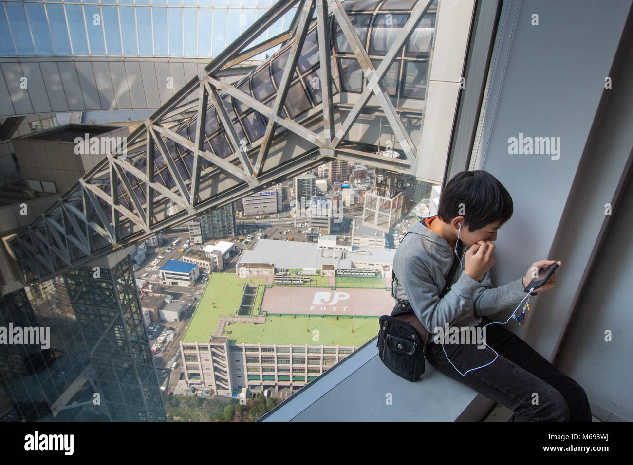Inside the Umeda Sky Building is the nineteenth-tallest building in Osaka Prefecture, Japan, and one of the city's - Stock Image