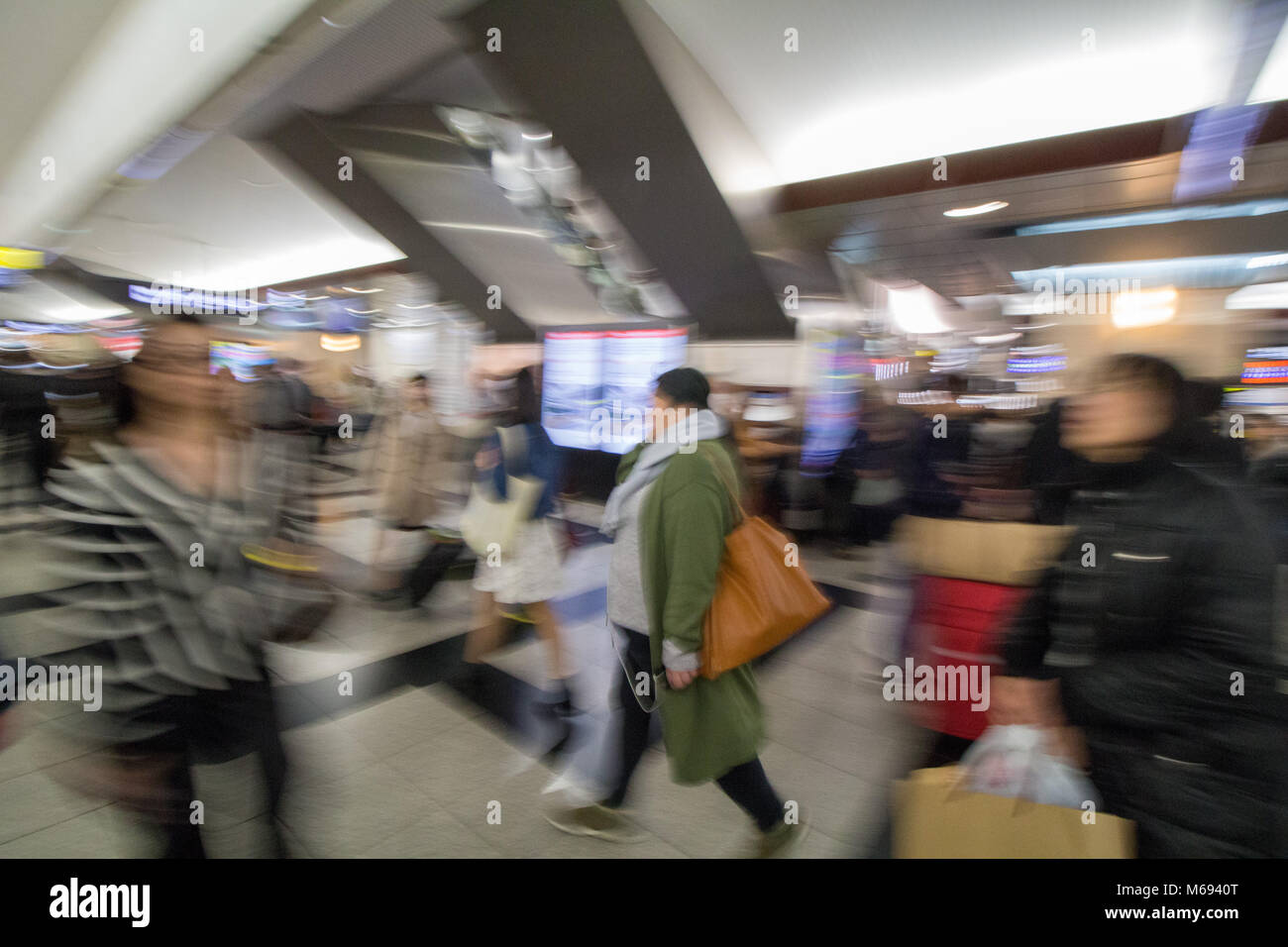 The busy concourse of Osaka train station, Japan, as people rush for trains. - Stock Image