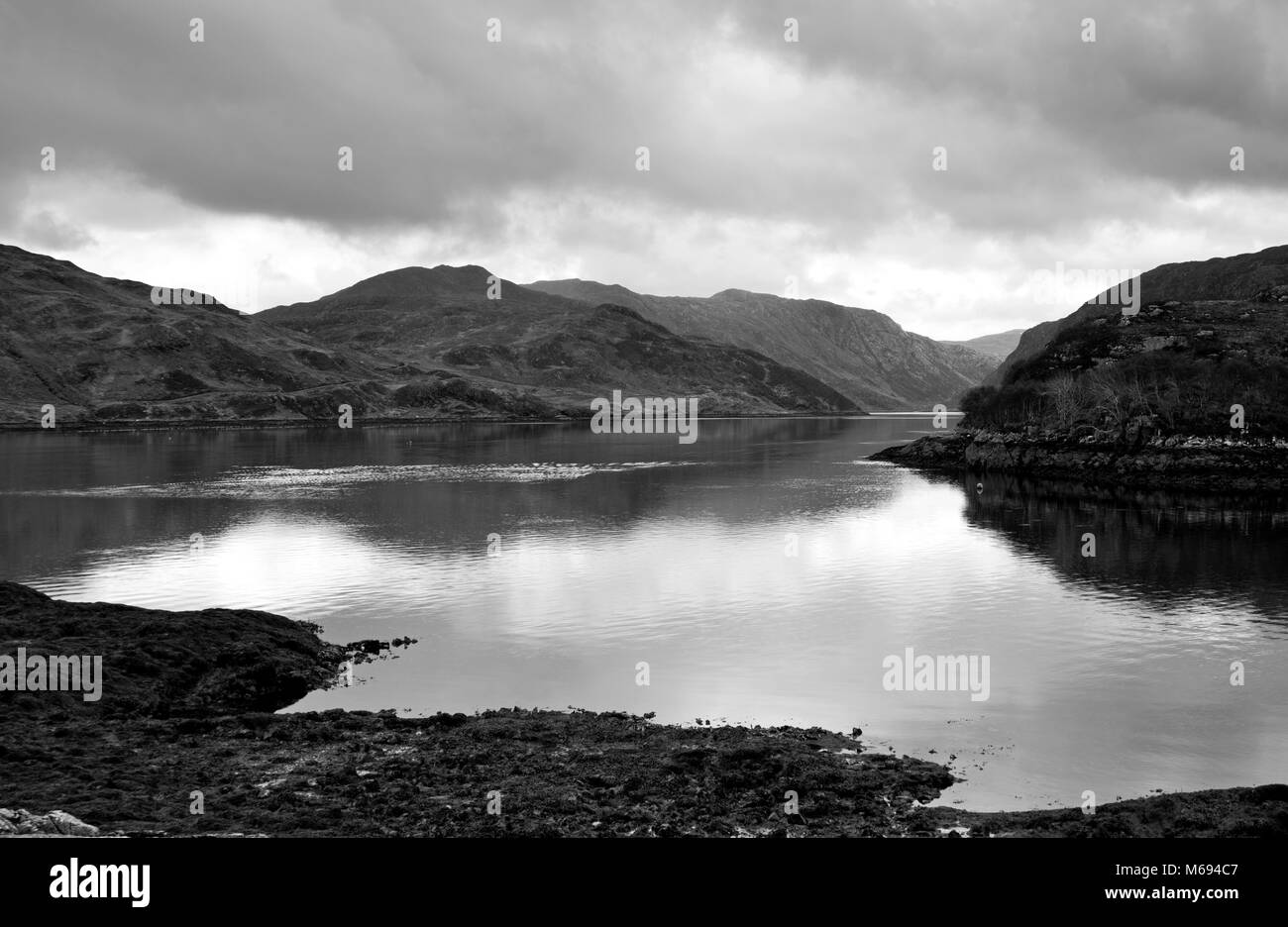 North coast 500 - Loch Glendhu at low tide, seen from Kylesku on a calm and cloudy day, Sutherland, Scottish Highlands, - Stock Image