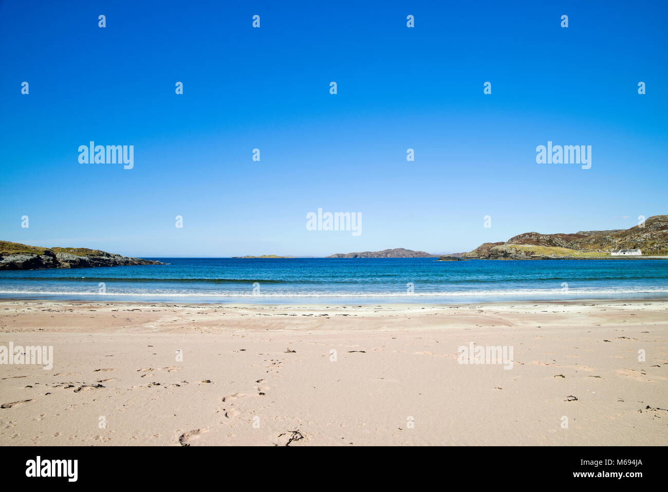 Deep blue sky and calm sea at the beautiful sandy beach at Clashnessie Bay, Assynt, on the North Coast 500 route, - Stock Image