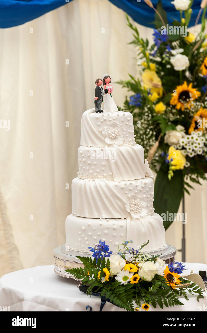 Wedding Day cake with his and hers figures sat on top of the iced ...