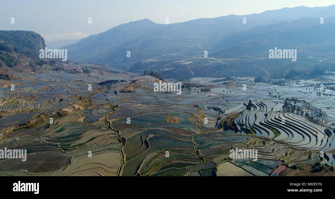 View into a valley showing the magnificent Yuanyang Rice Terraces sloping down the mountainsides. UNESCO World Cultural - Stock Image