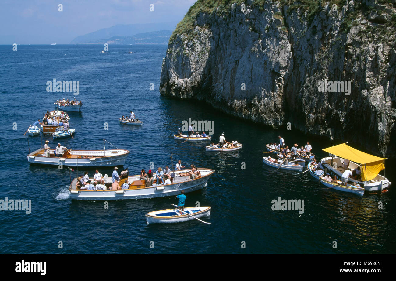 Boats in front of der Blue Grotto, Capri island, Italy, Europe - Stock Image
