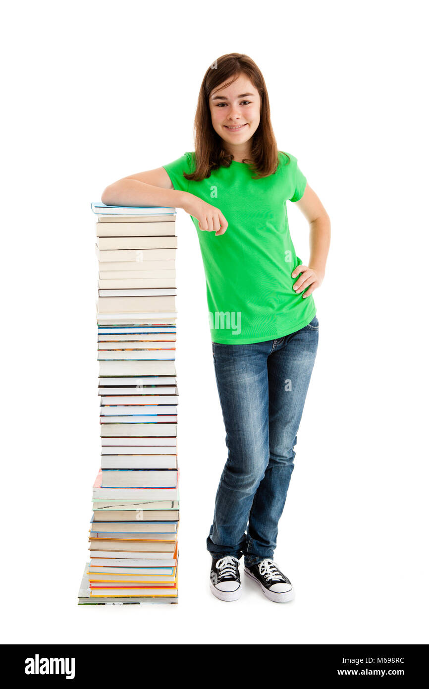 Student standing close to pile of books on white background - Stock Image