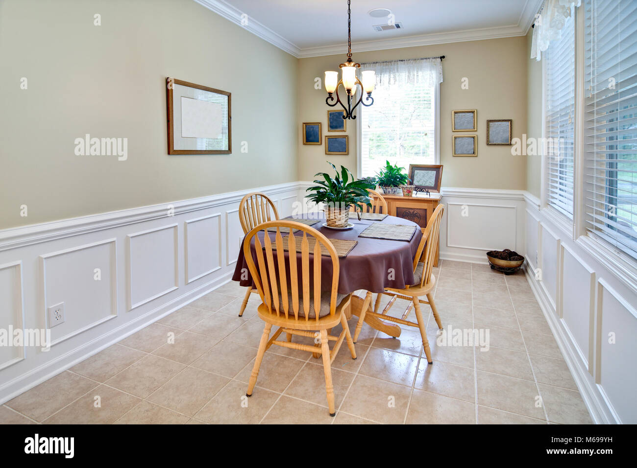Simple Dining Room With Wainscot And Crown Molding