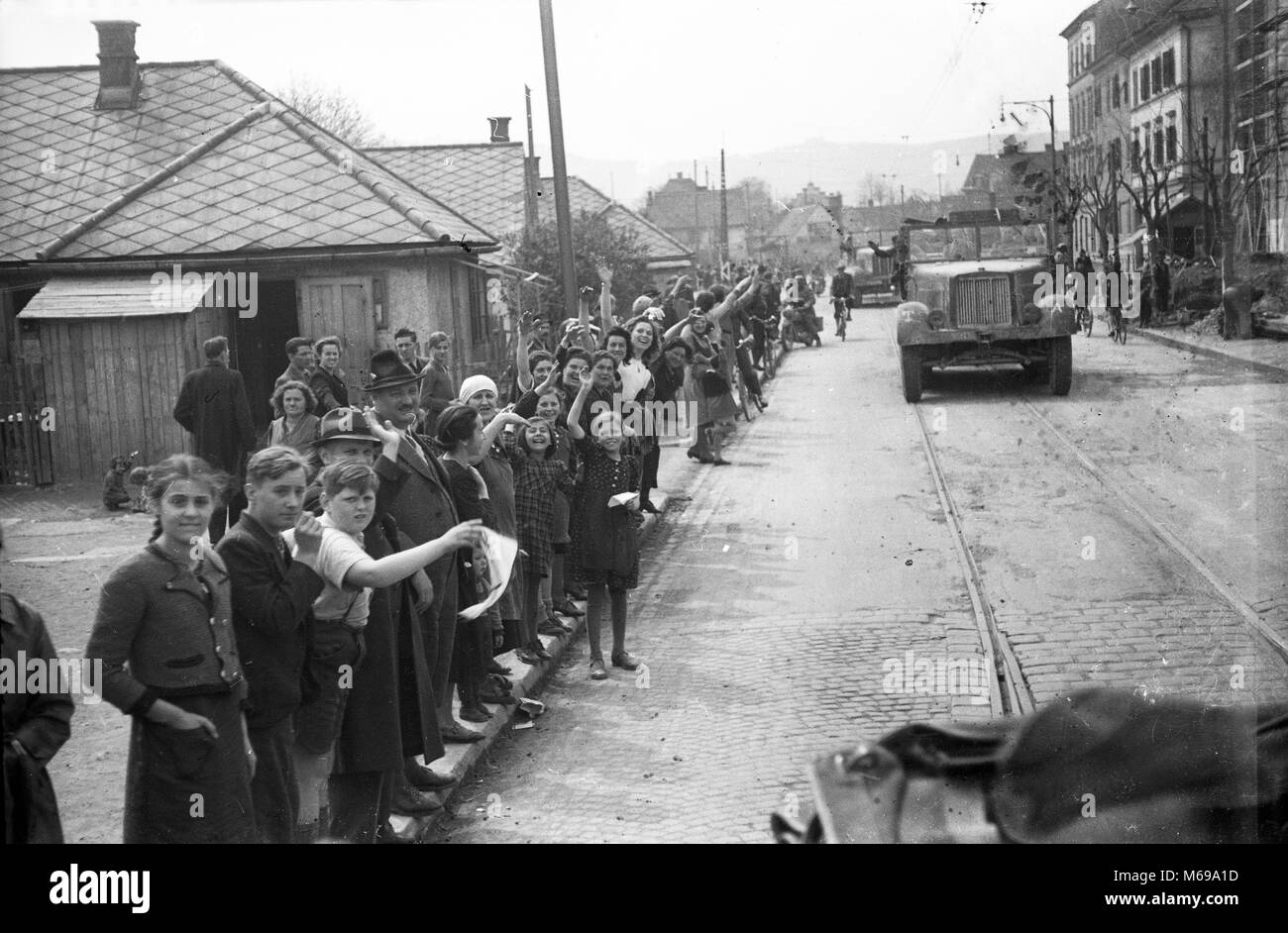 Local people waving to German troops in Yugoslavia April 1941 during WW2 German invasion of Yugoslavia. - Stock Image