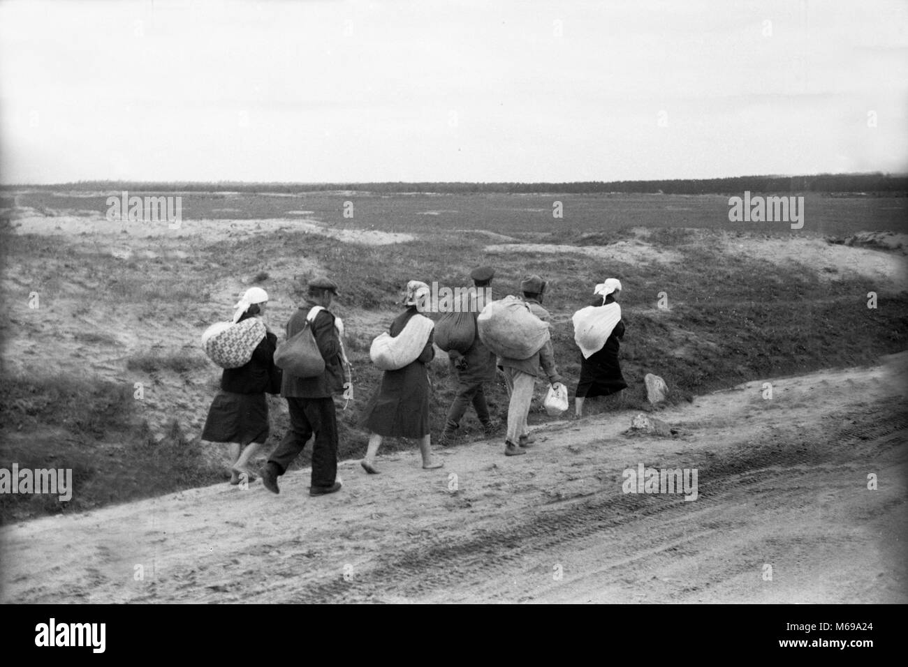 Bare footed refugees July 1941 WW2 German Army Soldiers Passing Russian Civilians, USSR, during Operation Barbarossa - Stock Image