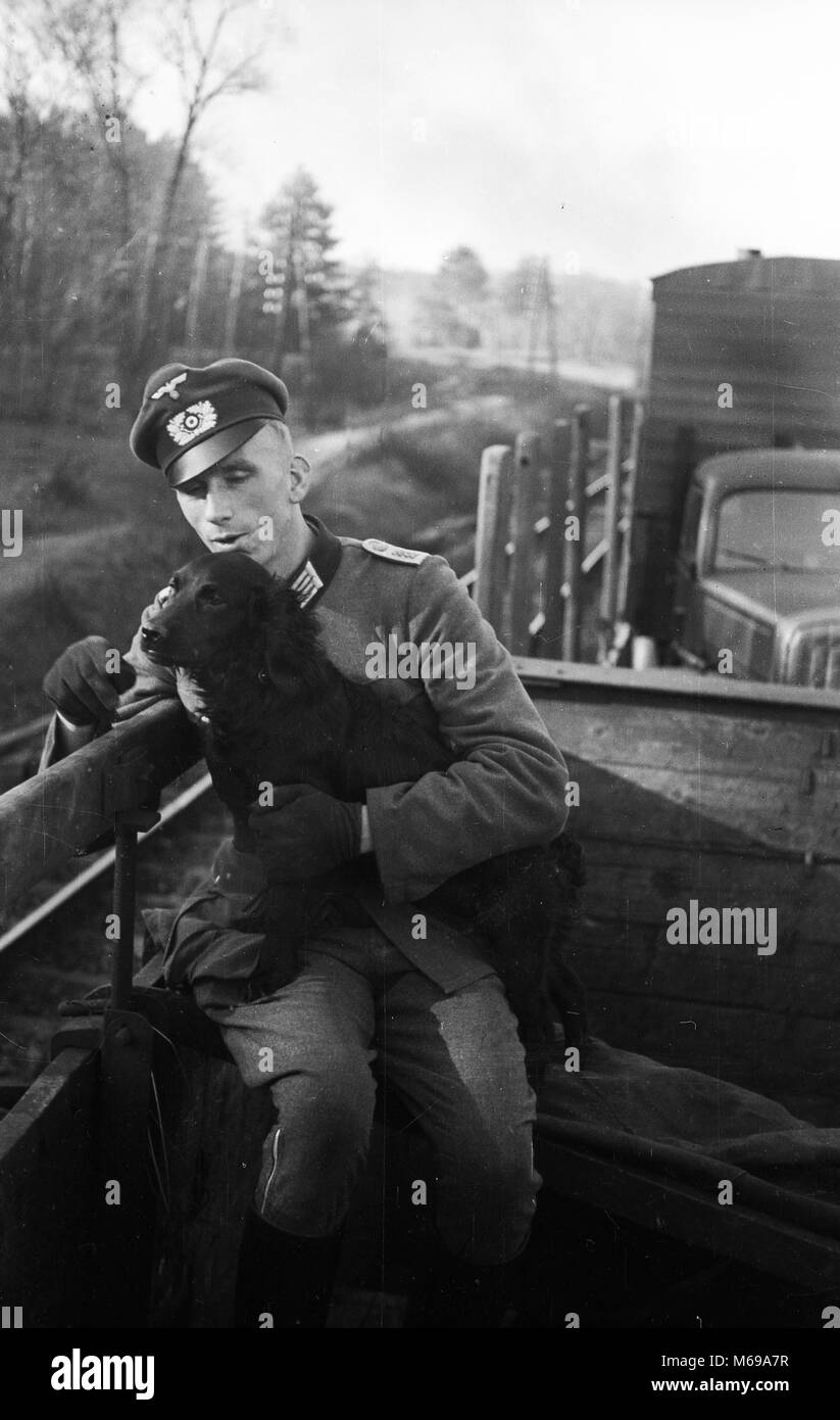 Yugoslavia April 1941 WW2 German Army Soldier & Dog on train during the invasion of Yugoslavia - Stock Image