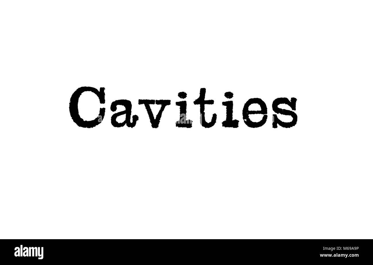 The word Cavities from a typewriter on a white background - Stock Image