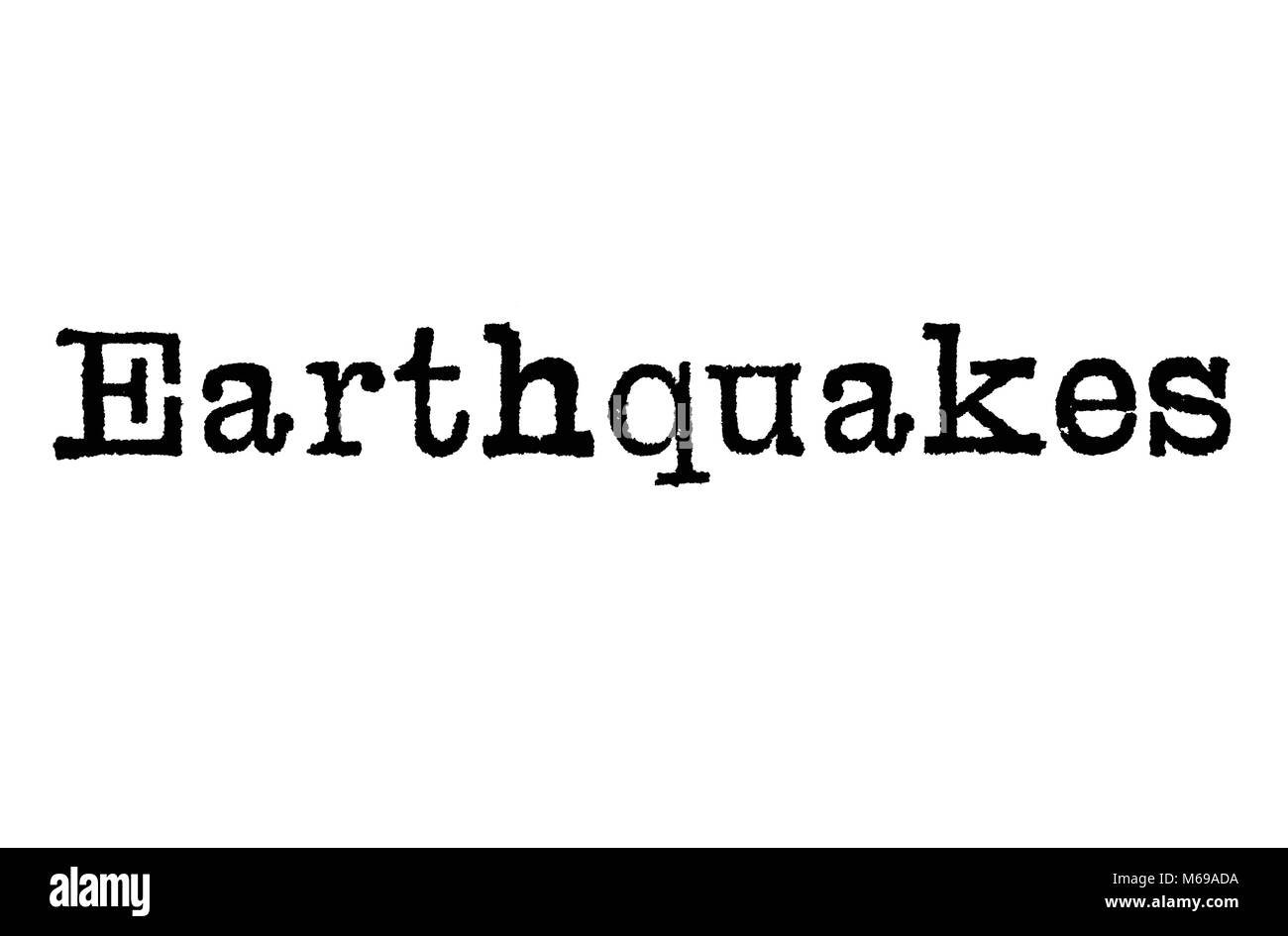 The word Earthquakes from a typewriter on a white background - Stock Image