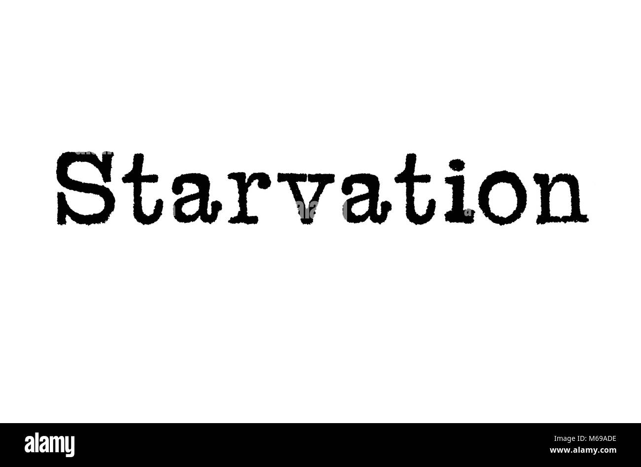 The word Starvation from a typewriter on a white background - Stock Image