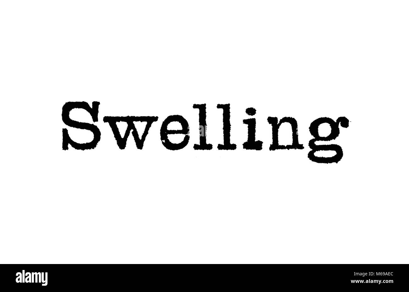 The word Swelling from a typewriter on a white background - Stock Image