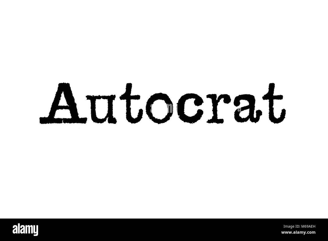 The word Autocrat from a typewriter on a white background - Stock Image