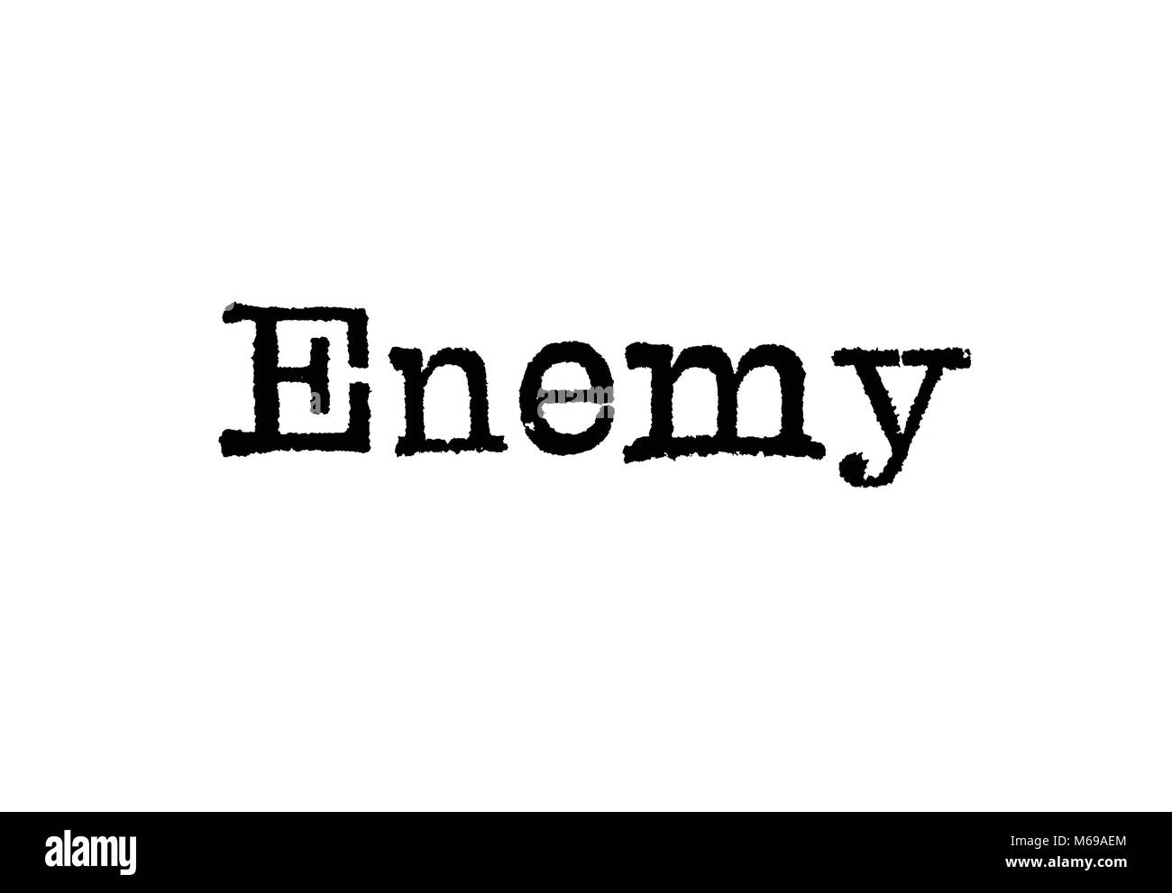 The word Enemy from a typewriter on a white background - Stock Image