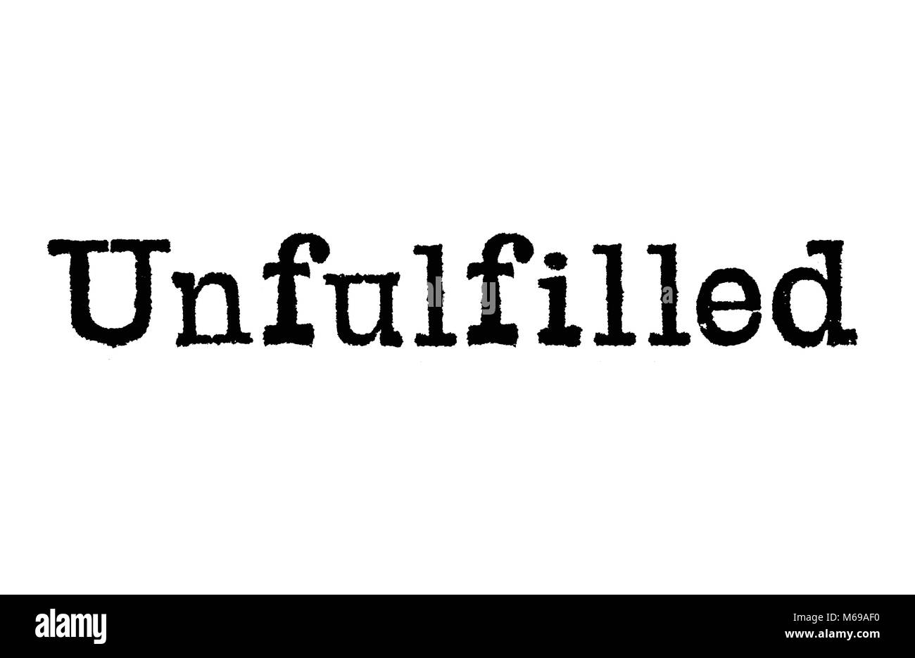 The word Unfulfilled from a typewriter on a white background - Stock Image