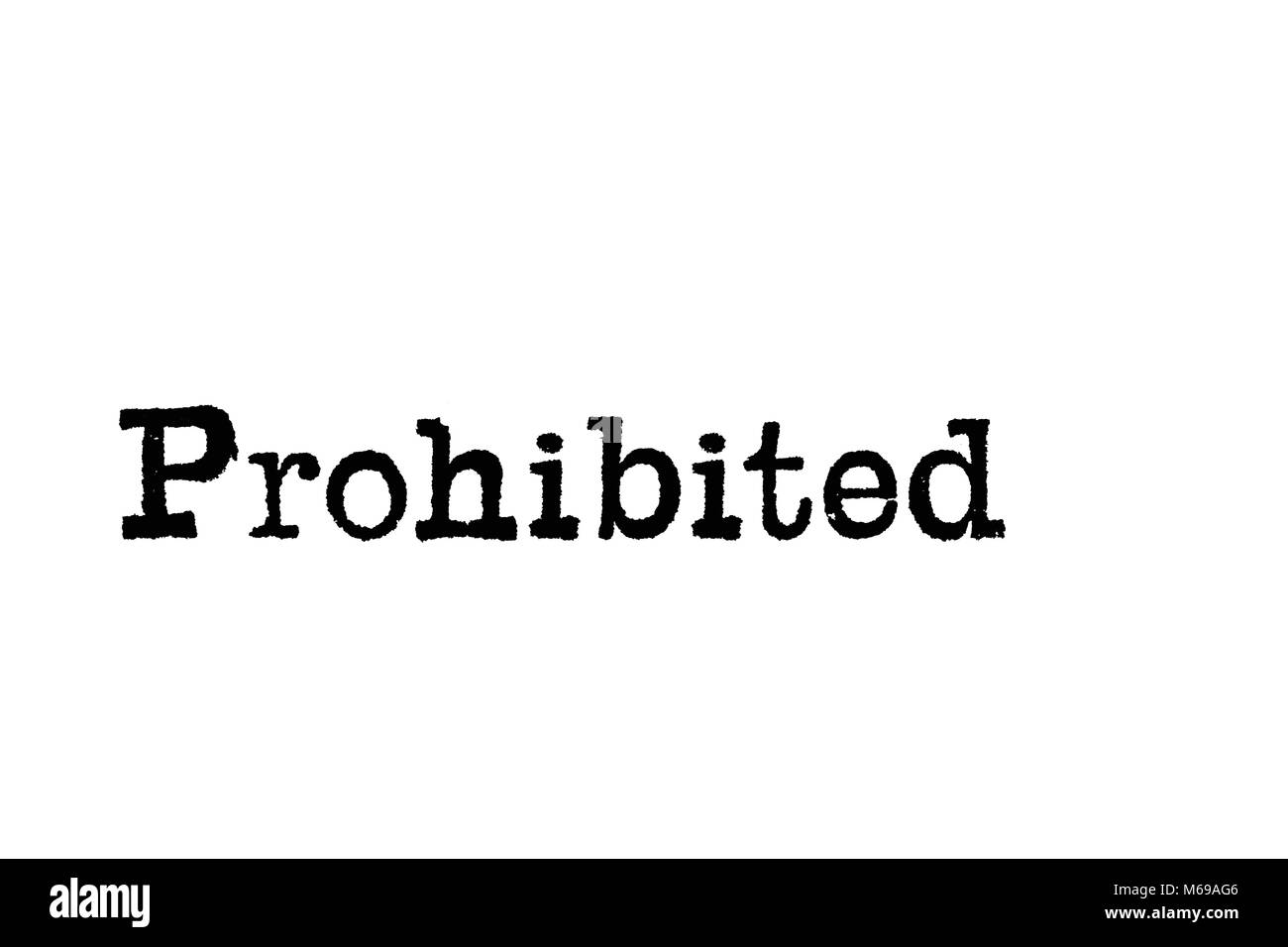 The word Prohibited from a typewriter on a white background - Stock Image