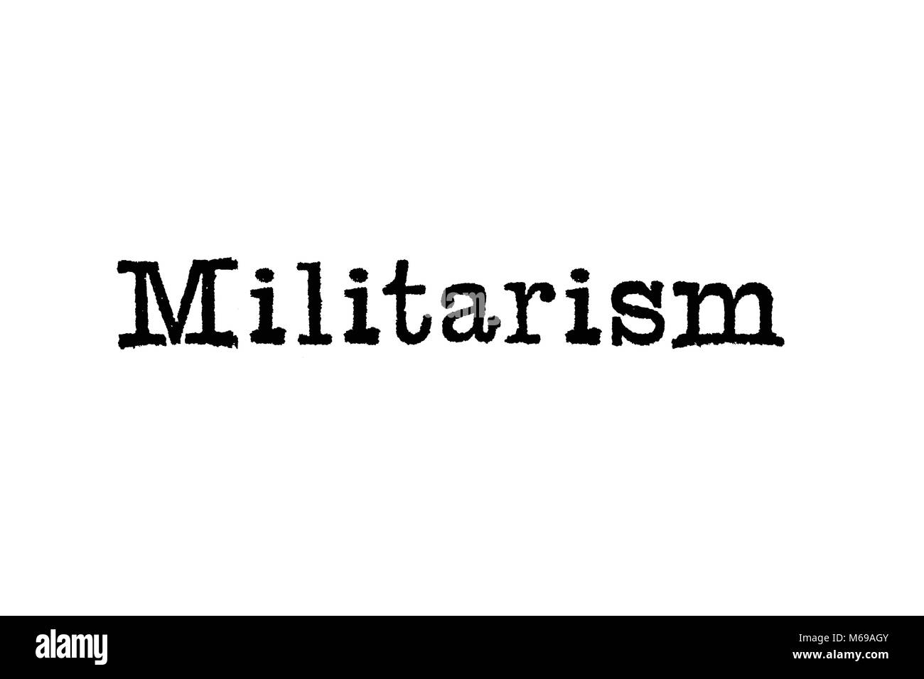 The word Militarism from a typewriter on a white background - Stock Image