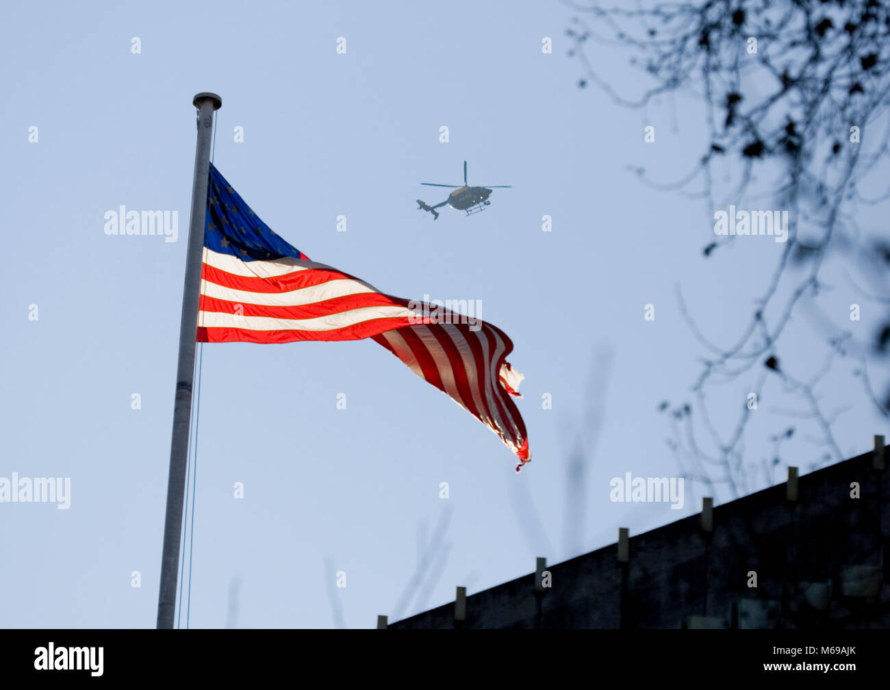 Police helicopter flying above American embassy during the women's march on London, January 2017 - Stock Image