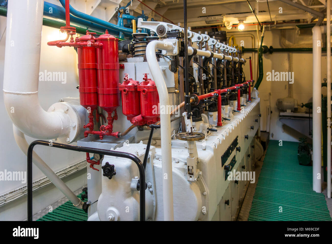 6-cylinder 510 hp engine in engine room of the last Iceland trawler Amandine, renovated fishing boat now serves - Stock Image