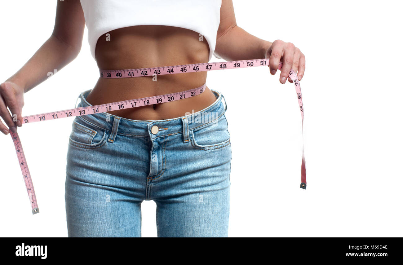 Woman is measuring waist after weight loss. Diet concept - Stock Image