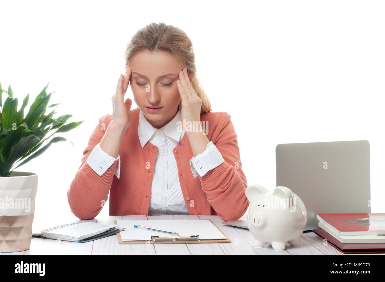 Exhausted businesswoman working at office desk is having an headache and stressful, too much work - Stock Image