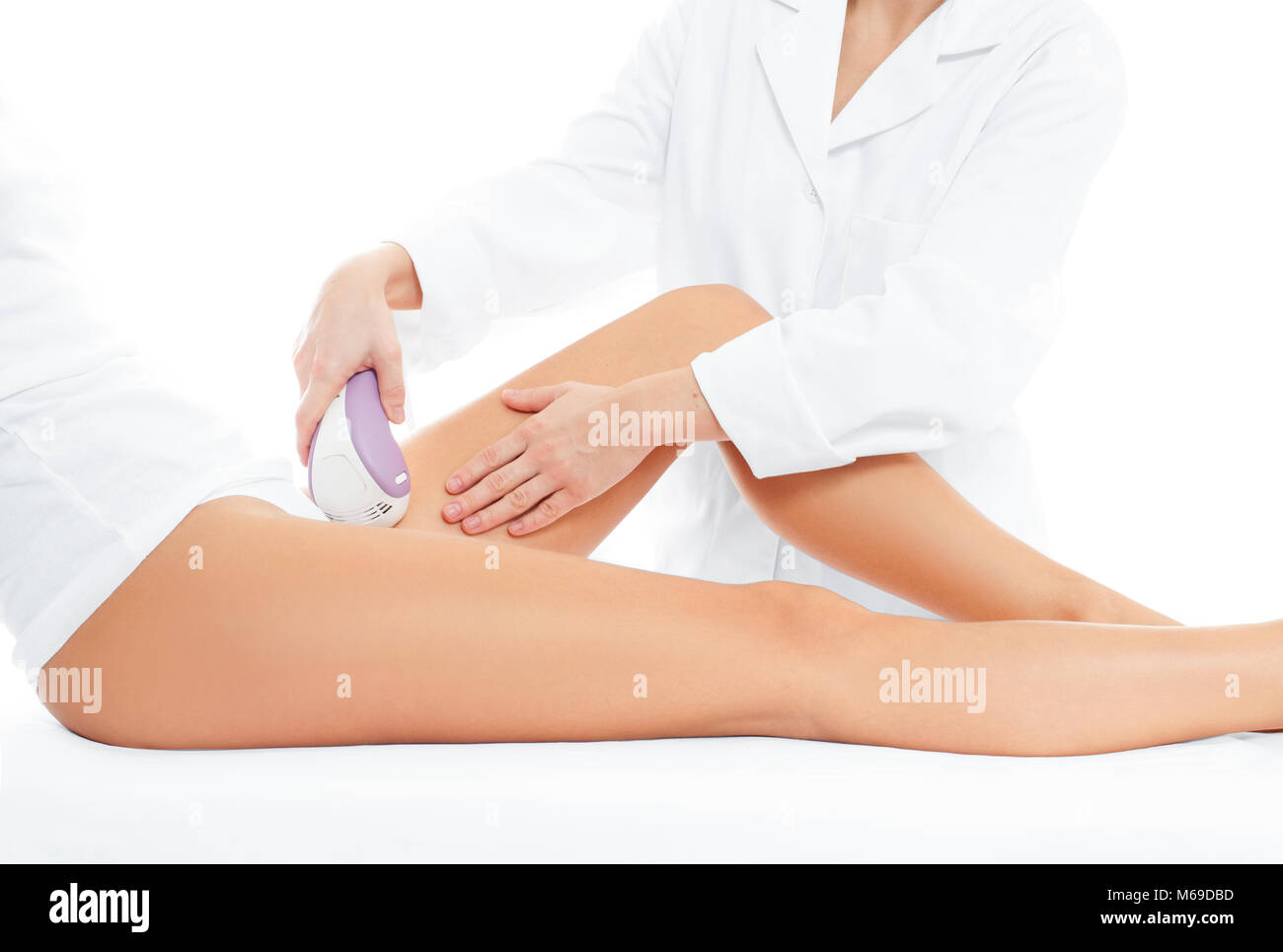 Depilation. Beauty.  Spa. Woman on laser hair removal treatments thighs and bikini area - Stock Image