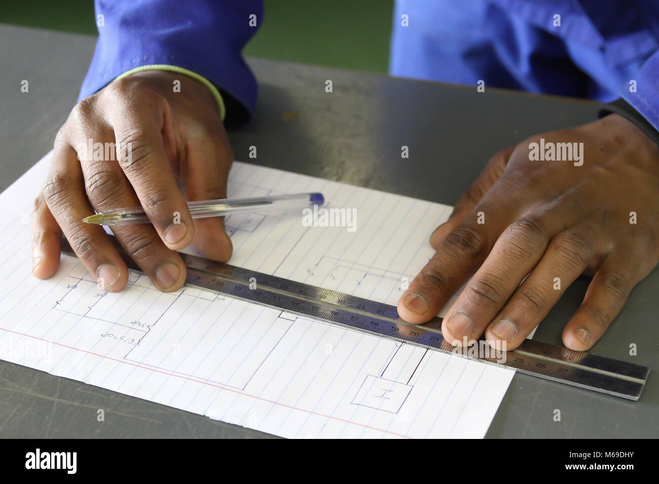 Electrical Drawing Stock Photos Images Draw Diagram African Mans Hands Practicing To At Trade School Image