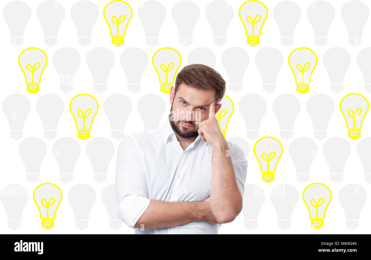 Business man having an bright idea light bulb concept. Handsome man thinking and dreaming Stock Photo