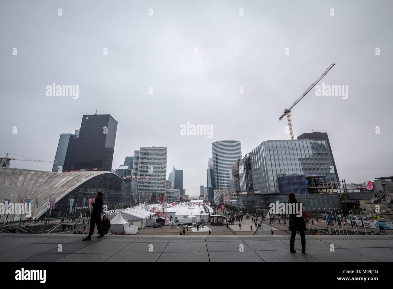 PARIS, FRANCE - DECEMBER 20, 2017: People contemplating La Defense district skyline from the Esplanade. La Defense - Stock Image