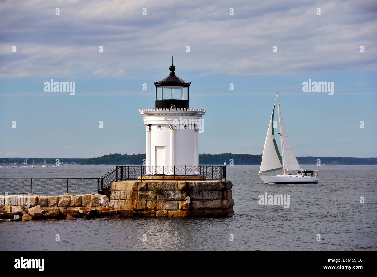 Sailing Past Portland Breakwater Lighthouse in Maine, on a warm summer day. - Stock Image
