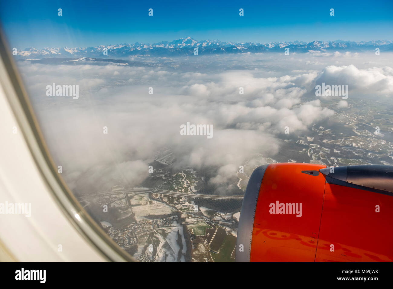 View from a passenger plane, alpine mountain peaks of the Swiss Alps in Switzerland, Europe - Stock Image